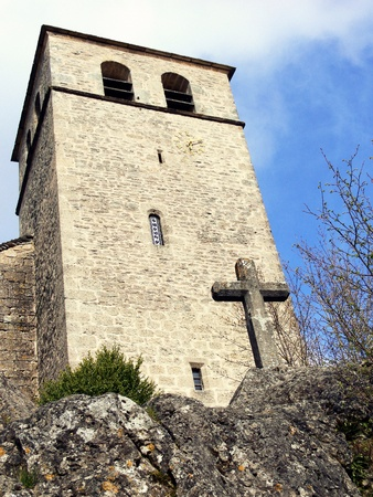 templars: Stone cross before a bell tower, La Couvertoirade, France