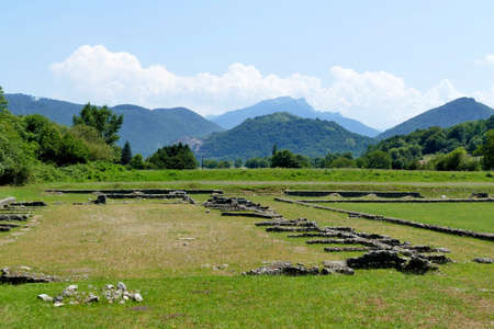 The Roman ruins at Saint-Bertrand-de-Comminges with the Pyrenees in the distance