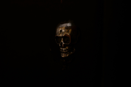 Metal skull levitating in air on black Background with free space. Mystical and spooky atmosphere