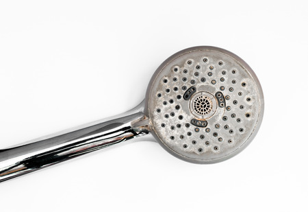 Close up shower head with the lime on it and placed on white background surface Banco de Imagens