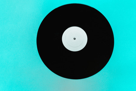 Vinyl LP on electric blue background surface with copy free space