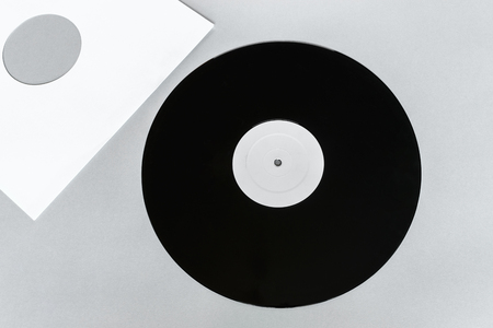 Vinyl LP on gray background surface with copy free space and white envelope near it Stock Photo