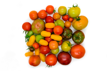 Fresh, ecological and colorful different type tomato isolated on white background Stock Photo