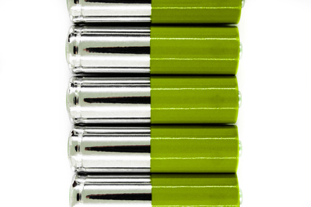 Composition of green and silver batteries placed in line and symbolize green energy, environment protection