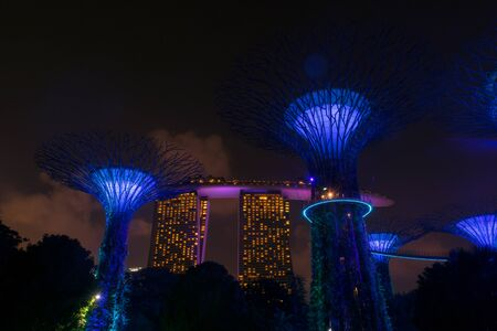 Singapore - 13 October 2018. Night view of Gardens By The Bay and Marina Bay Sands hotel