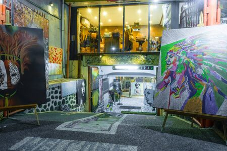 Bali, Indonesia 12 OCT 2018. Nightlife street in Bali and painting shop in basement 報道画像