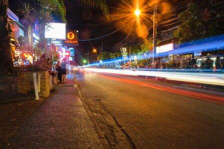 Bali, Indonesia 12 OCT 2018. Nightlife street in Bali with bars in background 報道画像