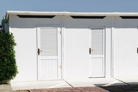White color beach huts in Rimini beach resort, Italy