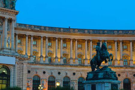 Hofburg palace with statue for prince Eugene von Savoyen during late evening illuminated by yellow light in Vienna, Austria Reklamní fotografie