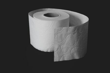 Unwrapped white toilet paper roll on black matte background with copy space Stock fotó