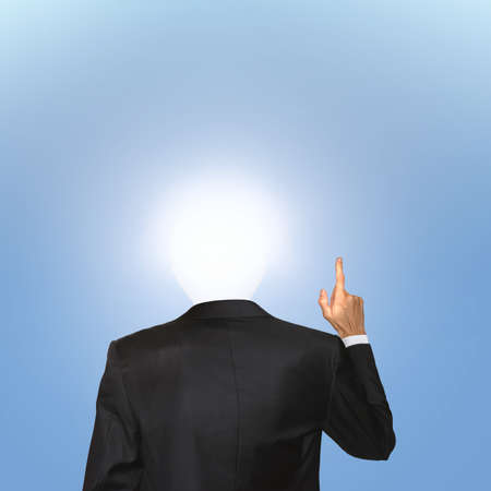 Business concept. Man in black suit hold one finger up with the enlightened bulb instead of his head symbolizes new idea or innovative thinking Banque d'images