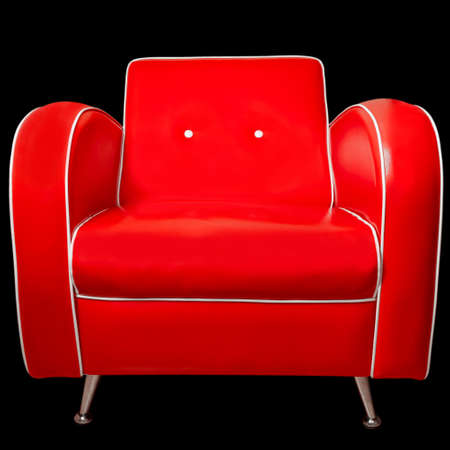 Luxury red armchair with white edgings and metallic legs isolated on black background