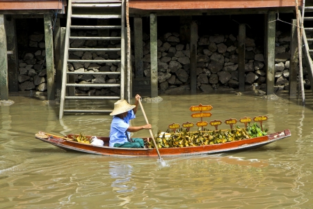 amphawa: Seller in rowboat at Amphawa of Thailand  Editorial