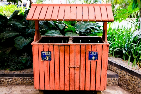 segregate: Separation between recycle and non recycle from wooden public bin in China