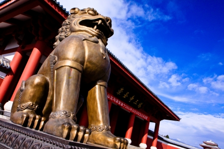 Lion statue at the entrance to protect temple in Dali, China photo