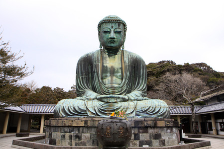 Front view of Daibutsu giant statue in sitting position at Kamakura of Japan photo