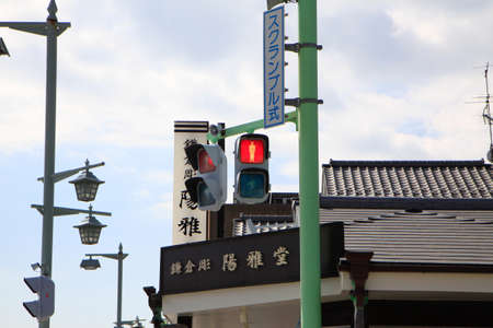 Traffic signals light in to control human in Japan photo