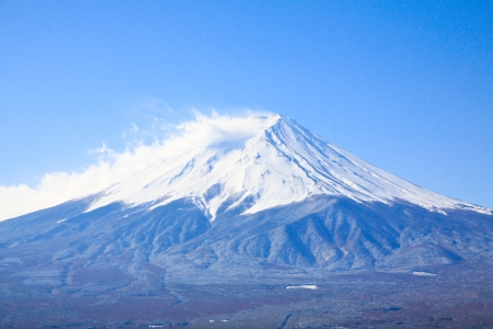The mist and snow on Fujiyama in Japan photo