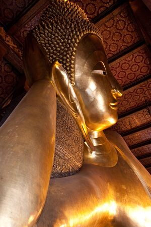 Half of reclining buddha in Wat Pho of Bangkok, Thailand