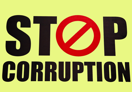 the corruption: Stop corruption in yellow background Stock Photo