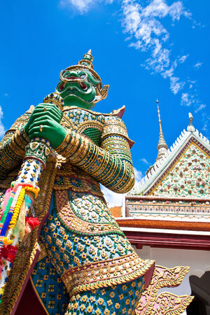 Measure giant at temple of dawn, Thailand photo
