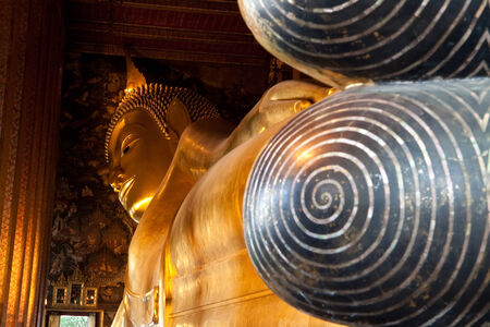reclining: Golden reclining buddha in temple of Thailand