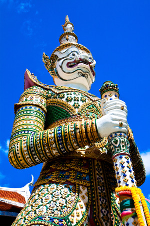 Close up of white guardian stupa in Thailand photo