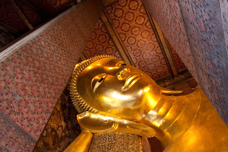 Face of golden buddha in temple photo