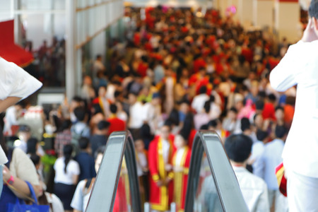 overcrowded: Blur of crowd background from escalator Stock Photo
