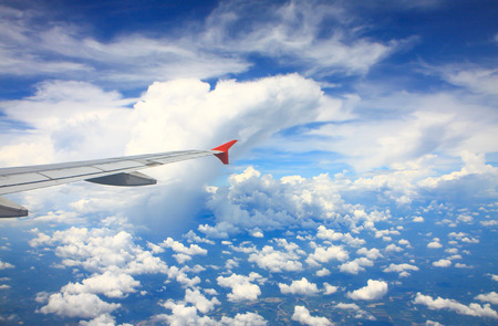 airplane wing: Airplane wing background and monster clouds texture Stock Photo