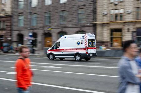 Kiev, Ukraine - July 14, 2019. Khreshchatyk. A white ambulance quickly drives along a wide city street. Motion blur Stock Photo - 134500877