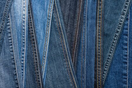 Denim fashion. Blue jeans background. Seams and stitches of different shades and textures. Top view
