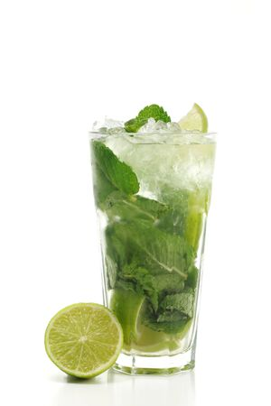carbonated: Refreshment Acoholic Drink made of White Rum, Sugar, Lime, Carbonated Water and Mint. Lime Garnish. Isolated on White Background.