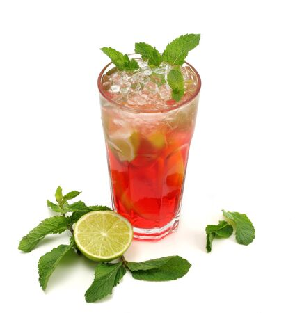 Refreshment Soft Drink made of Black Tea, Orange, Grenadine Syrup, Lime and Mint. Isolated on White Background. photo