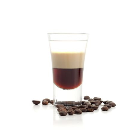 coffee crop: Hard Drink made of three Liqueur: Coffee Liqueur, Cream with Irish Whiskey. Coffee Crop Garnish. Isolated on White Background.