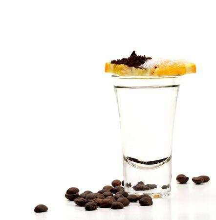 coffee crop: Hard Drink: Vodka, Lemon Slice, Salt and Cinnamon. Coffee Crop Garnish. Isolated on White Background.