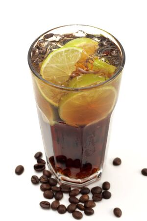 highball: Refreshment Highball Drink made of Rum, Vodka, Gin, Tequila, Cola, Lemon and Coffee Crop. Isolated on White Background. Stock Photo