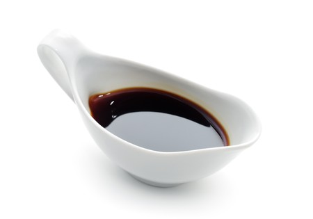 Japanese or Chinese Soy Sauce in Suace-boat. Isolated over White Stock Photo