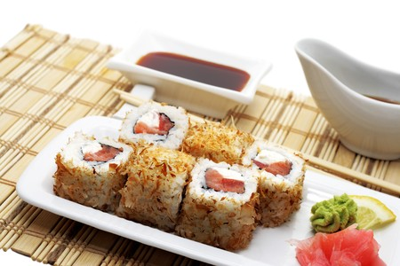 Hot Rolls in Tuna Chips Served with Soy Sauce and Chopsticks on Bamboo Napkin photo