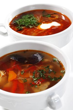 sours: Russian and Ukrainian Cuisine - Solyanka and Fish Soup is a Thicks, Spices and Sours Soups. Isolated on White Background