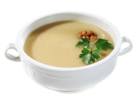 circassian: Onion Cream Soup Dressed with Circassian Walnut and Parsley Leaves. Isolated on White Background