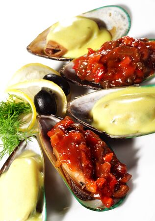 Cooked Mussels on a Plate Served with Lemon and Dill photo