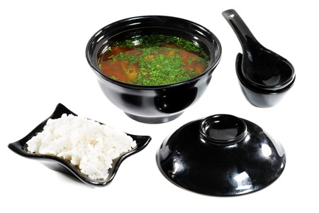 Japanese Soup in Black Dish. Isolated on White Background photo