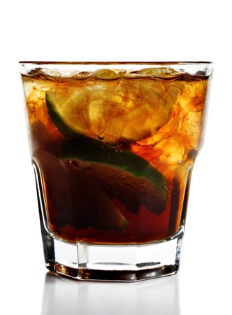Alcoholic Cocktail - Cuba Libre made of Cola, Lime and Rum. Isolated on White Background photo