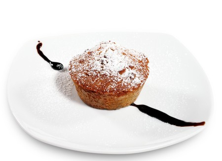 caster: Nut Cake Served with Chocolate Sauce and Caster Sugar Stock Photo