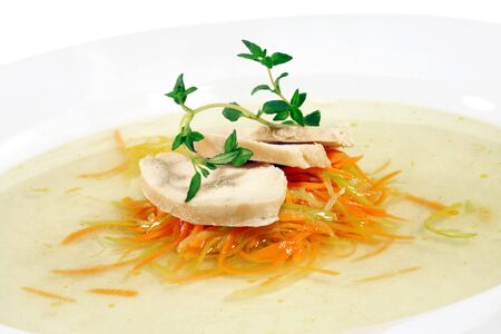 fare: Chicken Consomme with Julienne Vegetable Served with Green. Isolated on White Background