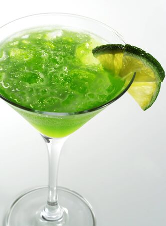 Alcoholic Cocktail made of Liqueur Lychee, Tequila and Lime Juice Garnish Lime Slice photo