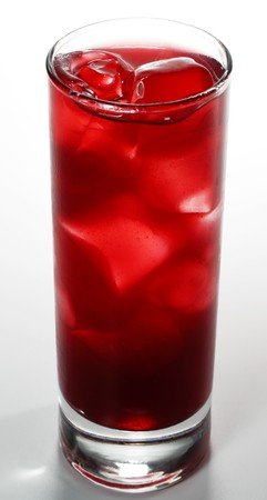 Red Alcoholic Cocktail made of Lychee Liqueur, Pineapple Juice and Cranberries Juice with Ice Cube photo