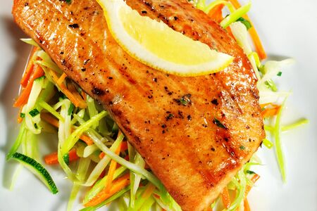 Fillet of Salmon with Julienne Peeler Vegetable and Lemon Slice Stock Photo - 4085964