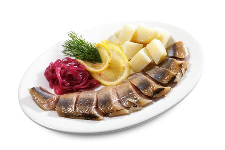 Red Herring with Onion and Potato. Isolated on White Background photo